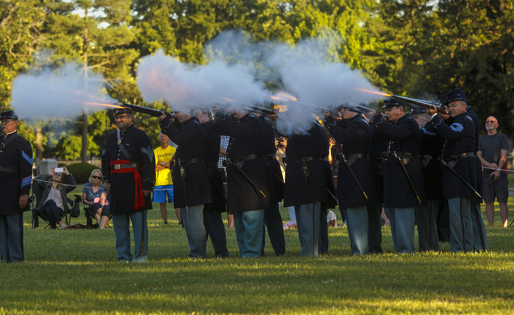 Members of the 114th Regiment Volunteers Reactivated fire a volley from their rifled muskets during the first of the weekly summer flag-lowering ceremonies at the Lincoln Tomb Tuesday, June 7, 2016.  Ted Schurter/The State Journal-Register