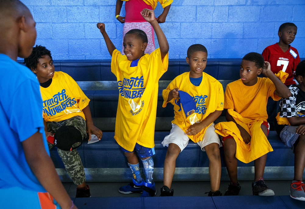 Jayden Jones stands up to model his new shirt before watching former Springfield Lanphier High School basketball standout Andre Iguodala and the Golden State Warriors play the Cleveland Cavaliers in Game 3 of the NBA Finals during a viewing party at the Boys and Girls Clubs of Central Illinois Wednesday, June 8, 2016. Participants at the free viewing party, sponsored by the Boys and Girls Clubs, the Andre Iguodala Youth Foundation, the YMCA and Walmart, enjoyed pizza and sandwiches and received hats and shirts. Ted Schurter/The State Journal-Register