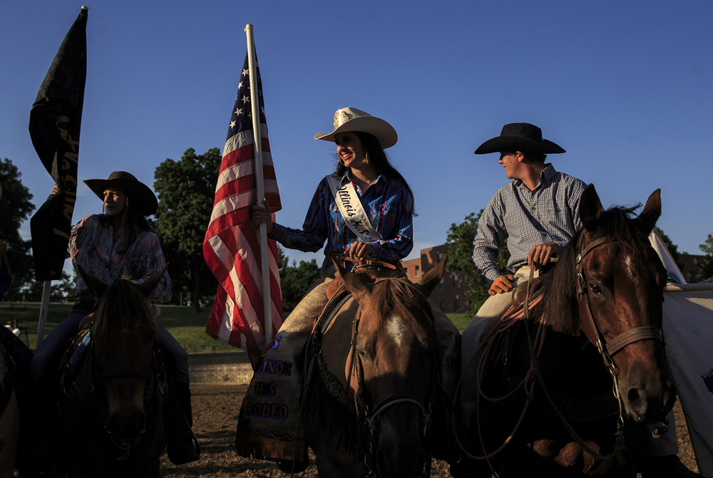 Kristine Stewart, of Yorkville, Ill., Miss Illinois High School Rodeo 2015-16, prepares to ride into the arena with the American Flag during the Illinois High School Rodeo Association State Finals at the Illinois State Fairgrounds Multipurpose Arena, Thursday, June 9, 2016, in Springfield, Ill. Stewart will be competing in the Barrel Racing and Pole Bending events. Justin L. Fowler/The State Journal-Register