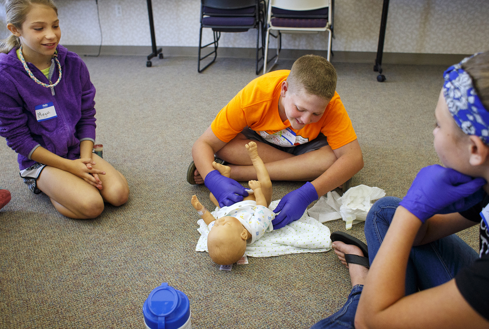 Aiden Millburg practices changing a diaper on a doll during the Safe Sitters class at St. John's Hospital Thursday, June 9, 2016. The class is designed to teach 11- to 13-year-olds everything from how to handle an emergency while babysitting, first aid and behavior management. Ted Schurter/The State Journal-Register