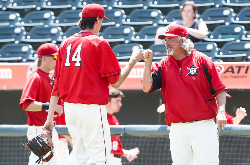Springfield baseball head coach Jim Steinwart gets a fist bump from Springfield's Ethan Klay (14) after the Senators get out of the third inning against Lemont during the IHSA Class 3A State Tournament Championship at Silver Cross Field, Saturday, June 11, 2016, in Joliet, Ill. Justin L. Fowler/The State Journal-Register