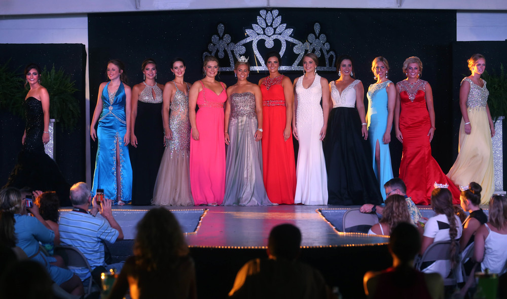 2015 Sangamon County Fair Queen Megan Urbas is at center as the 11 contestants taking part in the evening gown portion of the pageant for this year's fair queen pageant stand on stage to applause. David Spencer/The State Journal-Register