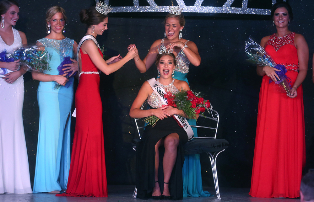 Kerby Ingram is crowned the 2016 Sangamon County Fair Queen by 2015 Fair Queen Megan Urbas Wednesday night. Eleven contestants took part in this year's pageant. David Spencer/The State Journal-Register