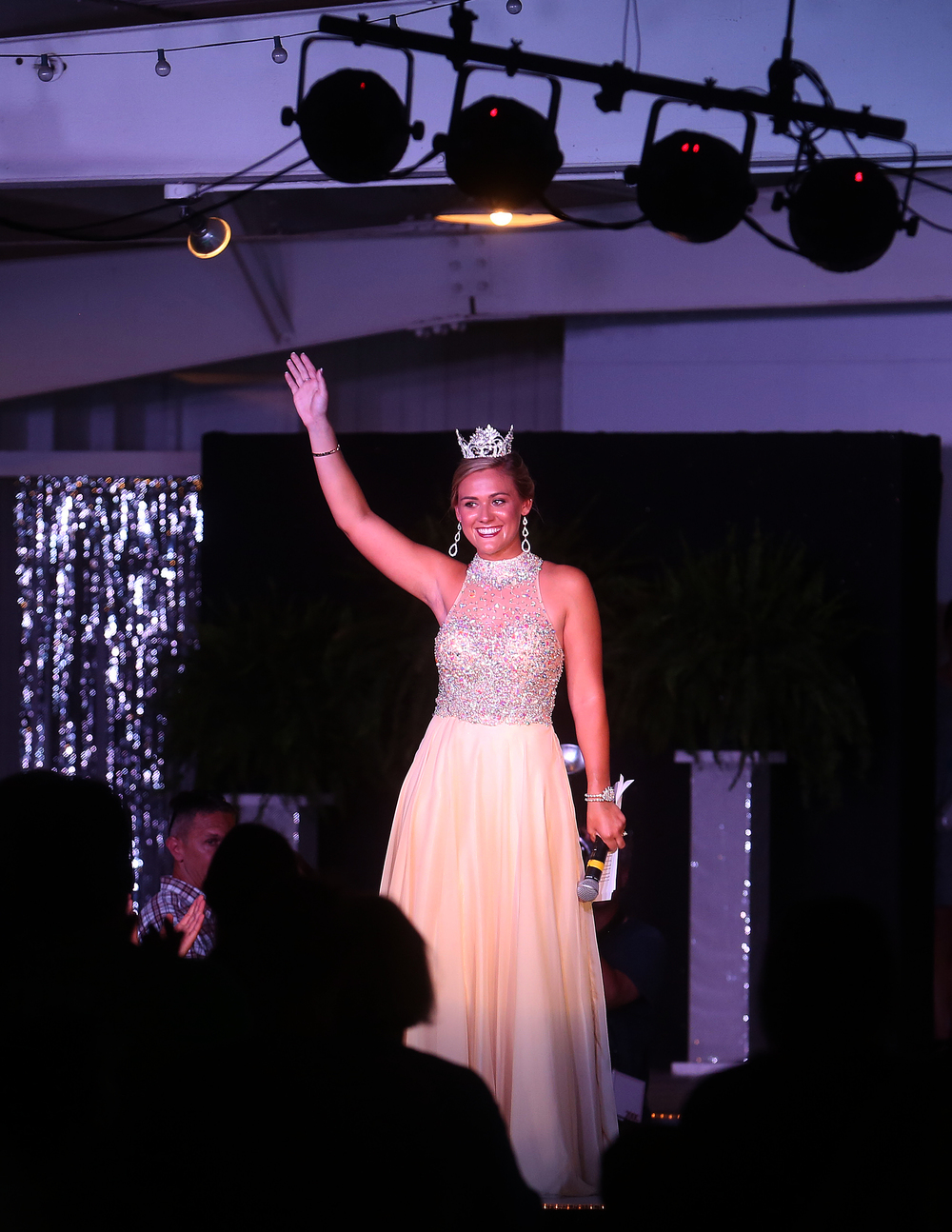 2015 Fair Queen Megan Urbas waves for the final time onstage moments after her final farewell Wednesday night. David Spencer/The State Journal-Register