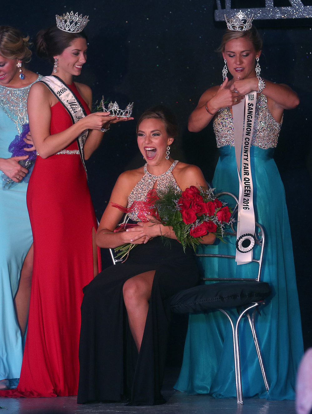 Kerby Ingram reacts while seated on her throne moments before being crowned. At left is 2016 Miss Illinois County Fair Queen Abby Foster of Danville. At right with sash is 2015 Sangamon County Fair Queen Megan Urbas. David Spencer/The State Journal-Register