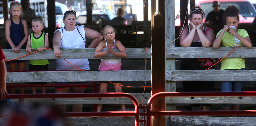 Fair goers watch the goat show judging from an adjacent barn at the Sangamon County Fair in New Berlin, Ill on Thursday, June 16, 2016. David Spencer/The State Journal-Register