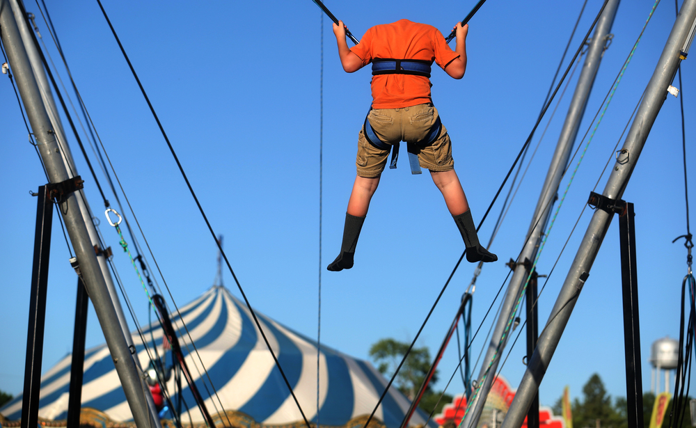 One fairgoer-who honestly did not lose his head-eyes the ground after liftoff on an attraction in the carnival area combining the feeling of bungee jumping from shorter heights at the Sangamon County Fair in New Berlin, Ill on Thursday, June 16, 2016. David Spencer/The State Journal-Register