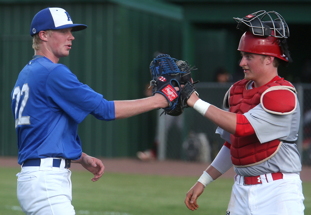All Area pitcher Tristan Weaver of Auburn at left is congratulated by catcher Johnny Steinwart of Pleasant Plains after finishing the third inning Tuesday. The 27th annual Baseball Classic was held between baseball all-stars from the Central State Eight Conference vs. all-stars from the Sangamo Conference plus Nokomis and Beardstown at Claude Kracik field on the campus of Lincoln Land Community College in Springfield on Tuesday evening, June 14, 2016. David Spencer/The State Journal-Register