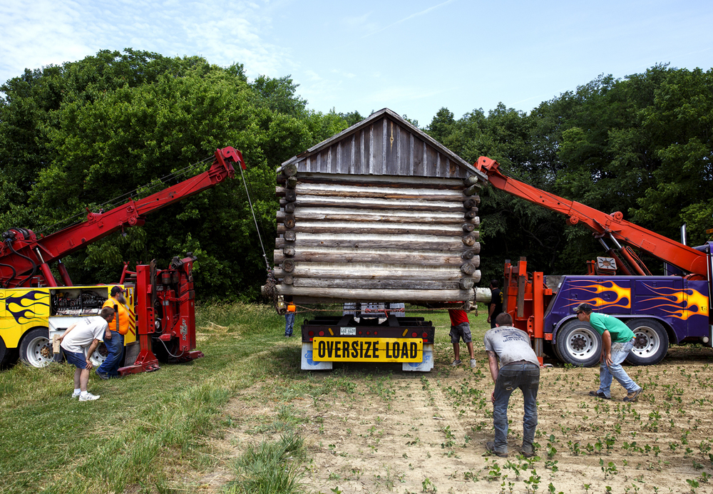 A small log cabin which sat for years across from Jefferson Elementary School in Lincoln was moved to its new location at the Creekside Outdoor Center for Environmental Education Tuesday, June 14, 2016. Creekside is a 4-acre site operated by Lincoln College and is located four miles north of the city. The cabin was built by Pete Fredericks in 2001 for the site near Jefferson School, which is now closed. Lincoln School Dist. 27 donated the cabin to Creekside. Rich Saal/The State Journal-Register