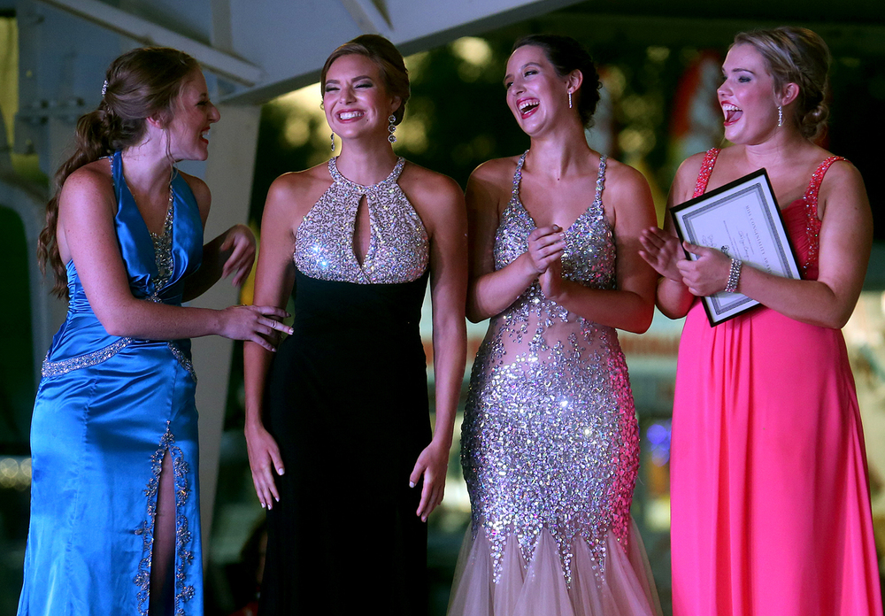 Kerby Ingram, second from left, reacts after being named the 2016 Sangamon County Fair Queen Wednesday night. Kerby Ingram of Springfield, a Sacred Heart Griffin graduate and current student at Saint Louis University, was crowned the 2016 Sangamon County Fair Queen during the 58th Annual Sangamon County Fair Queen Pageant on Wednesday evening, June 15, 2016 at the Sangamon County Fairgrounds in New Berlin. 2015 Fair Queen Megan Urbas crowned the new queen on the first day of this year's fair, which runs until June 19. Ingram will serve as official hostess of the Sangamon County Fair and will receive the $1,500 Robert Pfeffer Memorial Scholarship, a $1,000 wardrobe allowance and expenses paid to the State Pageant held in January 2017 during the Illinois Agricultural Association of FairÕs Convention held in Springfield. David Spencer/The State Journal-Register