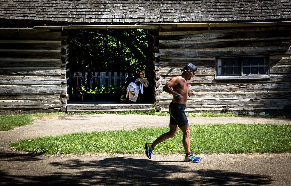 Participants finish the last section of the running course that takes them through Lincoln's New Salem State Historic Site during the Railsplitter Olympic Triathlon and Stovepipe Sprint Triathlon, Sunday, June 19, 2016, in Petersburg, Ill. The two events, one an olympic distance and the other a sprint, involved a swimming course on Lake Petersburg a bike course and then a run course that finished in the historic site. Justin L. Fowler/The State Journal-Register