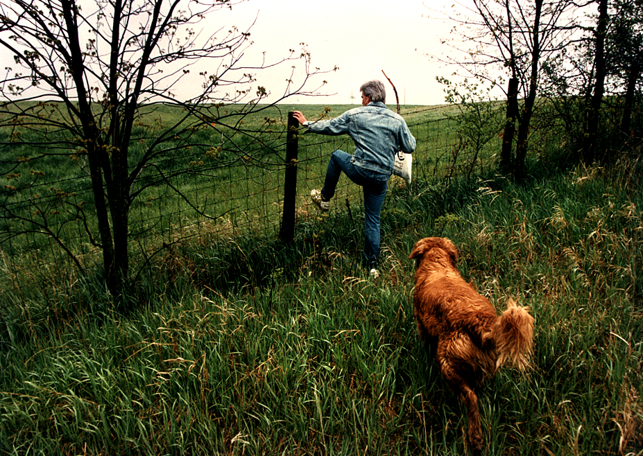 "For a Heartland story on ""The Magic of Morels"" published on May 20, 1994, I spent time with Loami resident and mushroom hunter Duane Brown, seen in this unpublished photograph along with his dog about to hop a fence in search of the early spring delicacies. David Spencer/The State Journal-Register"