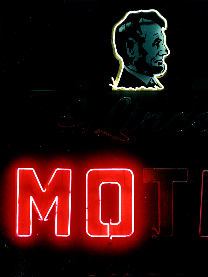 By the time I arrived in Springfield in 1989, Route 66 landmarks like the old Abe Lincoln Motel were showing their age, with several prominent red neon letters in its old sign darkened in this nighttime view taken in April, 1992 for a story on I did on the art of  neon sign making.  Now long gone, the motel, which in early postcards from the 1950's advertised itself as the Abe Lincoln Motel & Dining Room and was located at 2929 South Sixth Street, was demolished sometime in the mid to late 1990's and replaced by a Family Video store immediately north of the Cozy Dog restaurant. David Spencer/The State Journal-Register