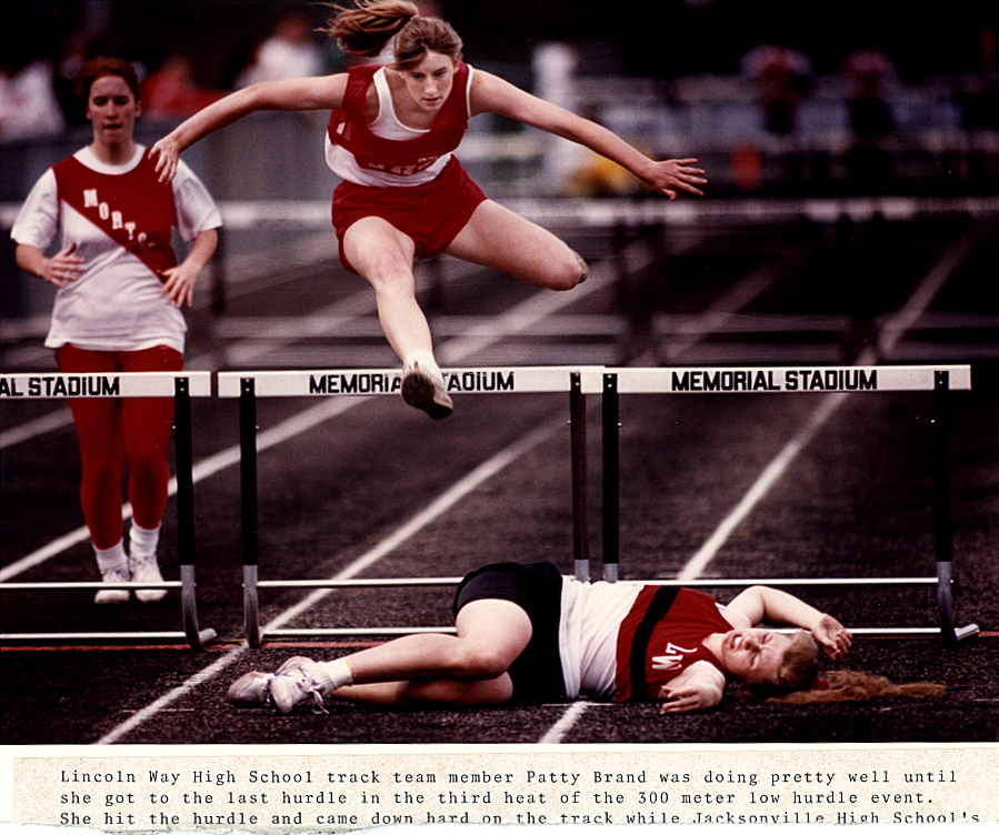 This hurdling mishap taken at Springfield's Memorial Stadium in late April, 1991 was something I could personally relate to as I was a hurdler on my own high school indoor and outdoor teams with several mishaps to my own name. Part of my original typed caption can be seen at bottom of photo. David Spencer/The State Journal-Register
