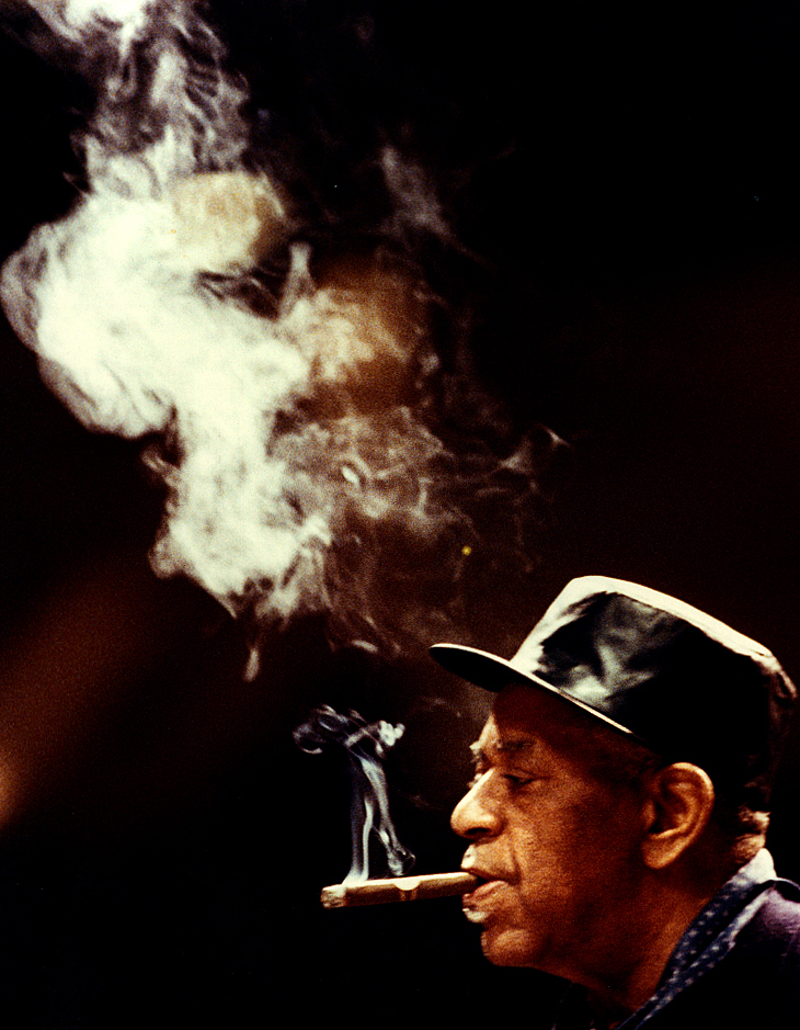 A cloud of smoke wafts upward from the cigar of jazz icon Dizzy Gillespie in early February, 1990 as he took the stage during a warm up with members of the Eastern Illinois Jazz Ensemble before that evening's concert at the former Sangamon State University. (now UIS) David Spencer/The State Journal-Register