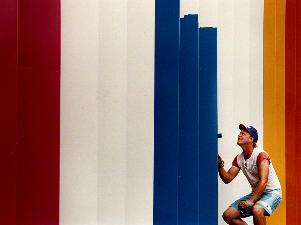 Before the official start of the Illinois State Fair in early August, 1990, I photographed Ace Sign Company employee Rick Monroe painting baffles adorning the facade of the Illinois Building in a multitude of colors. David Spencer/The State Journal-Register