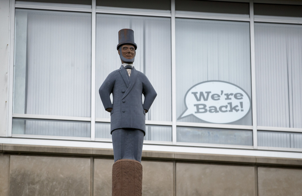 The Abe Lincoln Totem Pole had a message via a sign posted in a window in the upper floor letting patrons know that the Illinois State Museum is open for visitors after being closed for nine months, Saturday, July 2, 2016, in Springfield, Ill. Justin L. Fowler/The State Journal-Register