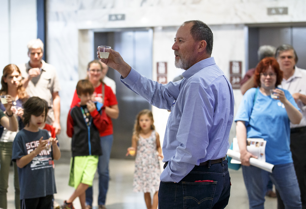 Michael Wiant, Interim Director of the Illinois State Museum, shares a lemonade toast with visitors as he welcomes them back during the reopening of the Illinois State Museum, Saturday, July 2, 2016, in Springfield, Ill. Justin L. Fowler/The State Journal-Register