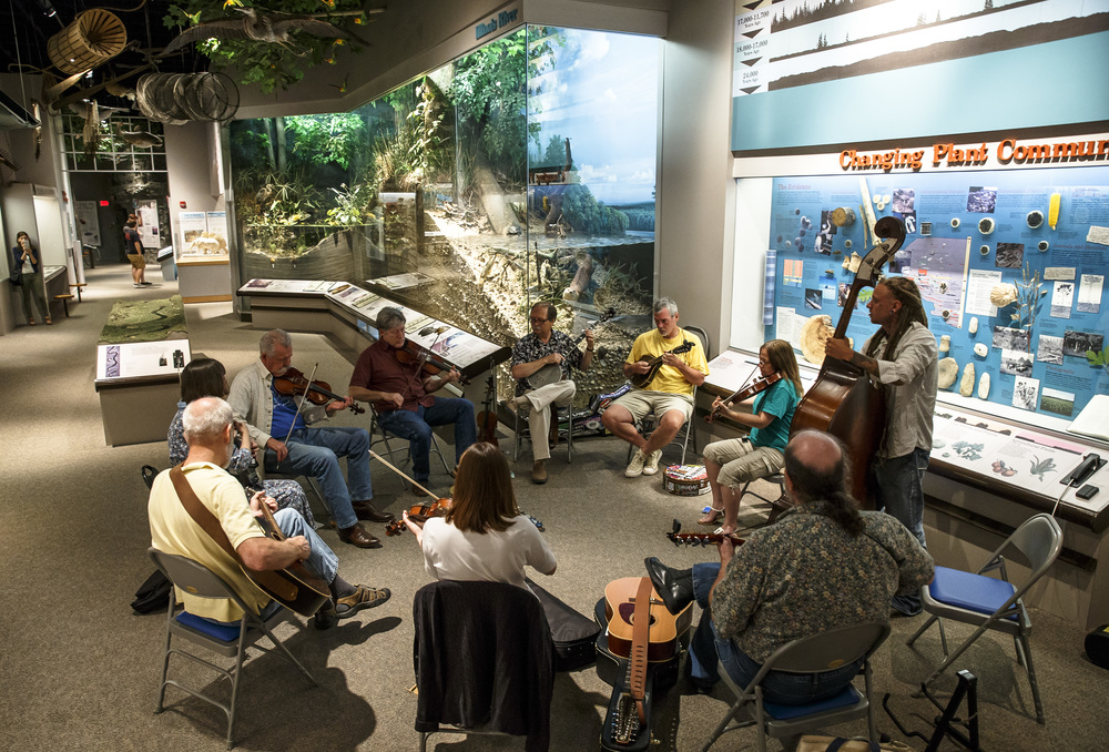 The Bug Trotters, a group of musicians from around the state, have a jam session inside the Changes exhibit during the reopening of the Illinois State Museum, Saturday, July 2, 2016, in Springfield, Ill. Justin L. Fowler/The State Journal-Register