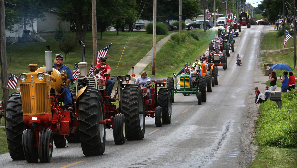 A convoy of antique farm tractors makes their way down S. Main Street during the parade Saturday morning. David Spencer/The State Journal-Register
