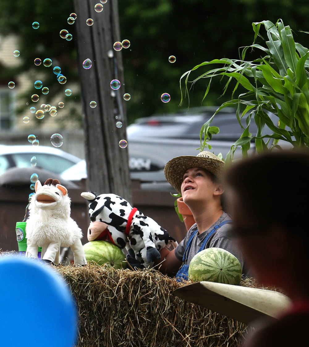A farming theme for the Loami Baptist Church float featured one young man dressed in overalls and a straw hat operating a bubble machine during the parade on Saturday. David Spencer/The State Journal-Register