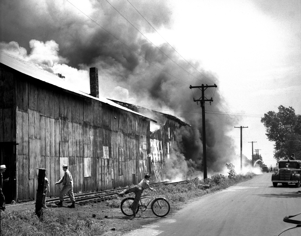 warehouse fire, Springfield Fire Department, fire fighters, July 30, 1947. File/The State Journal-Register