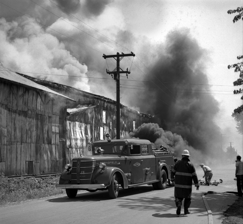 Springfield fire fighters on the scene of a fire that destroyed the Ridgely Avenue sale barn, 1301 Ridgely Ave., July 30, 1947. File/The State Journal-Register