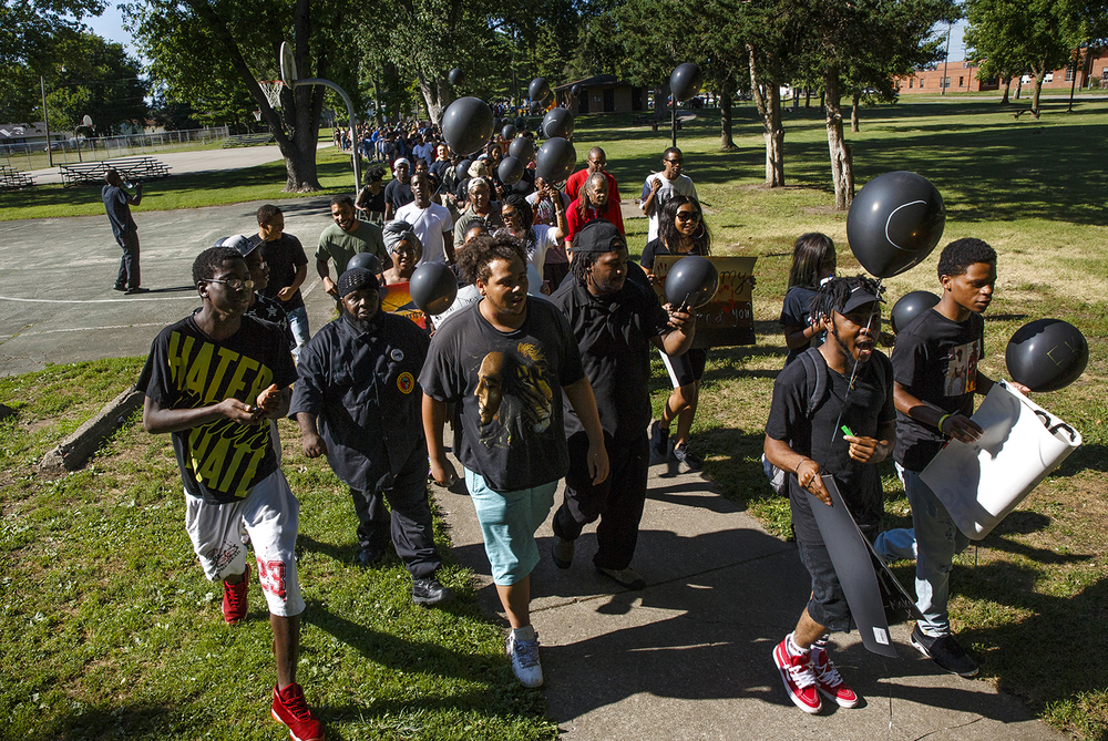 Event organizers Jaylin Netters and Gary Freemon lead marchers to the Illinois capitol building from Comer Cox Park Friday, July 8, 2016. The march to remember the victims of violence, including police shootings and the Dallas officers killed Thursday night.  Ted Schurter/The State Journal-Register