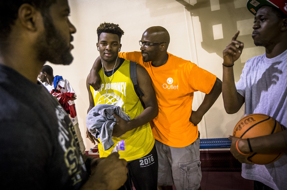 Mike Phelon, center, founder of The Outlet, talks with J.J. Lavow, a Southeast student and member of the Illinois Elite team, prior to their game starting during The Outlet's Hoop Journey summer basketball league at the Abundant Faith Christian Center, Monday, June 20, 2016, in Springfield, Ill. Justin L. Fowler/The State Journal-Register