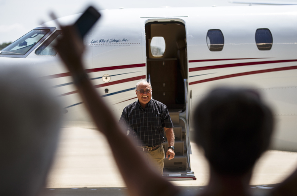 "Levi Ray & Shoup pilot Carl Catlin comes off a Cessna Citation X to cheers of family and friends awaiting his arrival for a surprise ceremony honoring him for 50 years of blemish-free flying at the Abraham Lincoln Capitol Airport, Thursday, June 30, 2016, in Springfield, Ill. Catlin was honored with the FAA's Wright Brothers Master Pilot Award which is the agency's top recognition for civilian pilots. ""That surprised me. IÕm glad I left my glasses on because I had some tears in my eyes,"" said Catlin of the ceremony. Justin L. Fowler/The State Journal-Register"