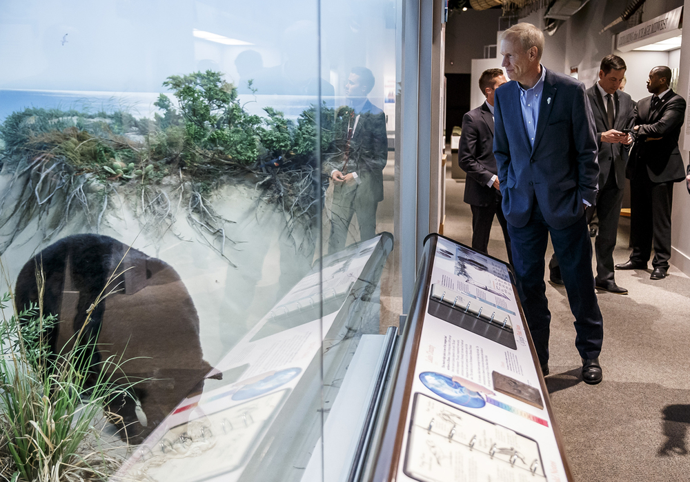 Illinois Gov. Bruce Rauner looks over the Lake Michigan dunes diorama while touring the Illinois State Museum before speaking during an event celebrating the re-opening of the museum, Thursday, June 30, 2016, in Springfield, Ill. Justin L. Fowler/The State Journal-Register