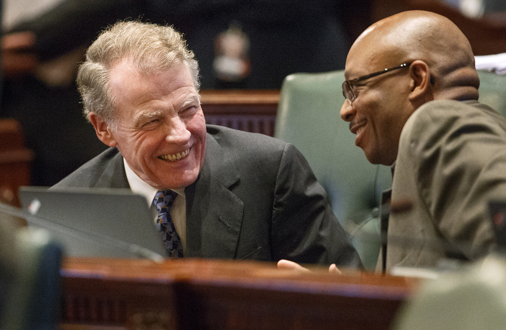 Illinois Speaker of the House Michael Madigan, D-Chicago, laughs with Illinois Rep. William Davis, D-East Hazel Crest, during session at the Illinois State Capitol Thursday, June 30, 2016. Ted Schurter/The State Journal-Register