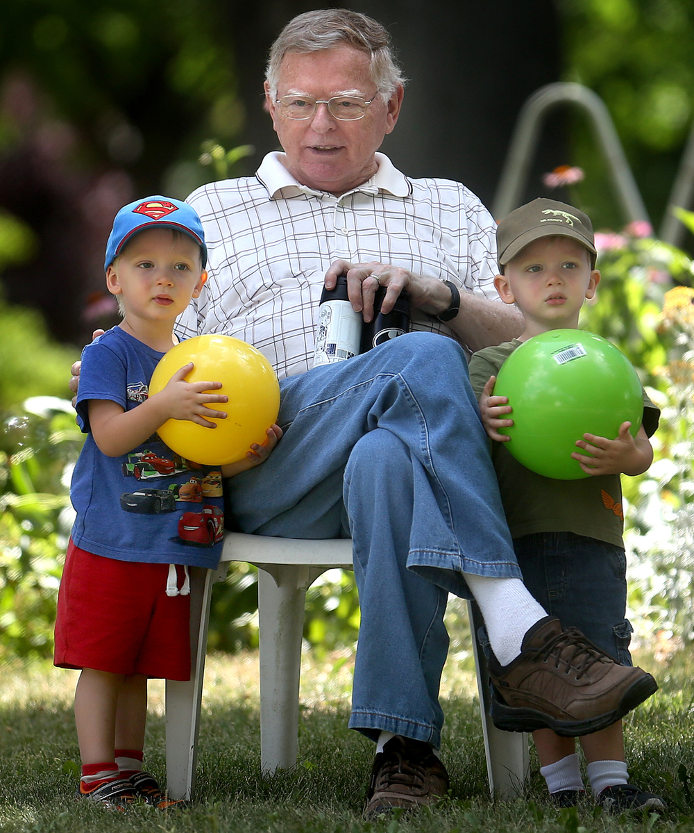 Tuesday saw a break in the weather locally, with cooler temperatures and lower humidity giving Springfield resident John Blankenberger a great excuse to venture outside and take to a lawn chair in the shade of his home while accompanied by grandsons Colin Drews, 2, left, and his twin Seth Drews. The Drews, visiting from California, were taking a break from playing. David Spencer/The State Journal-Register