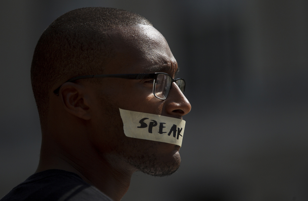 Leroy Newbon Jr. wears tape over his mouth during the Black Lives Matter rally at the Illinois capitol Saturday, July 9, 2016. Ted Schurter/The State Journal-Register