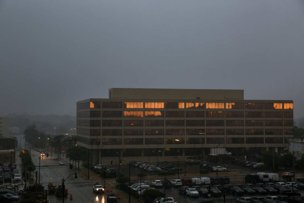 What remains of light in the morning sky is reflected in the gold-tinted windows of the Illinois Board of Education building as a thunderstorm moves into Springfield Thursday, July 7, 2016. Rich Saal/The State Journal-Register