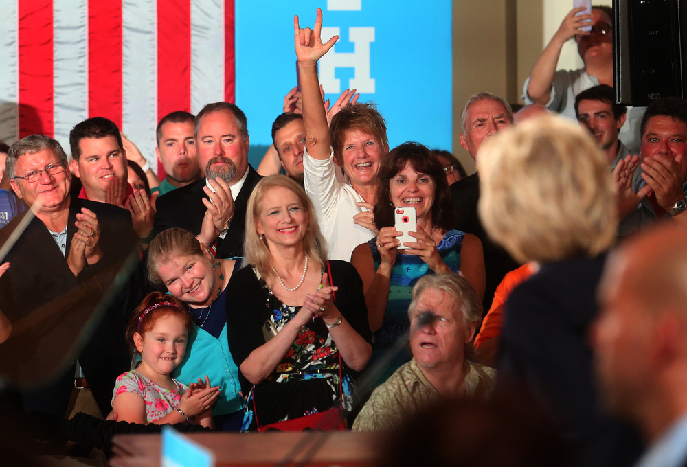 Those in attendance stood and applauded as Hillary Clinton turns to them at right before she spoke Wednesday. David Spencer/The State Journal-Register