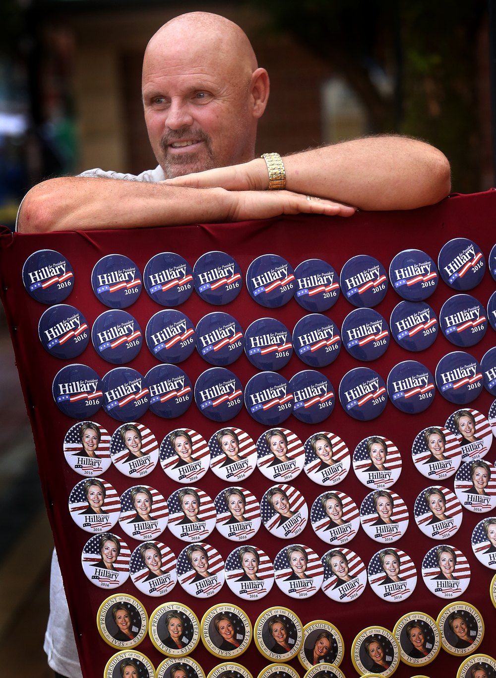 Hillary Clinton campaign button vendor Dave Mullen waits for a customer outside the Old State Capitol Wednesday. Buttons were priced at $3.00 each or two for $5.00. David Spencer/The State Journal-Register