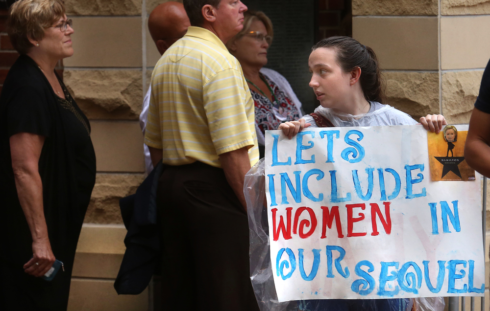 "Hillary Clinton supporter Maggie Shea of Pleasant Plains held a sign stating ""Lets Include Women in our Sequel"" outside the Old State Capitol Wednesday. David Spencer/The State Journal-Register"