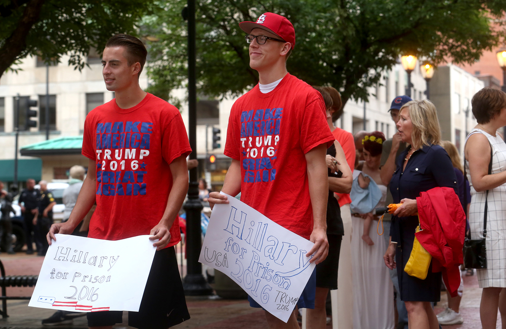 "Donald Trump supporters and Springfield residents Steven Cowles at left and Nate Bahr held signs outside the Old State Capitol Wednesday stating: ""Hillary for Prison 2016"". David Spencer/The State Journal-Register"