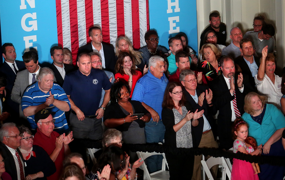 A portion of those invited stood and applauded Hillary Clinton at the conclusion of her speech early Wednesday afternoon from inside Representatives Hall. David Spencer/The State Journal-Register