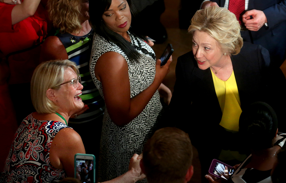 Hillary Clinton greets a supporter in the audience at the conclusion of her speech early Wednesday afternoon from inside Representatives Hall. David Spencer/The State Journal-Register