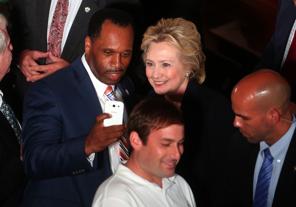 Hillary Clinton poses for a selfie along with Lanphier High School principal Artie Doss at the conclusion of her speech early Wednesday afternoon from inside Representatives Hall. David Spencer/The State Journal-Register