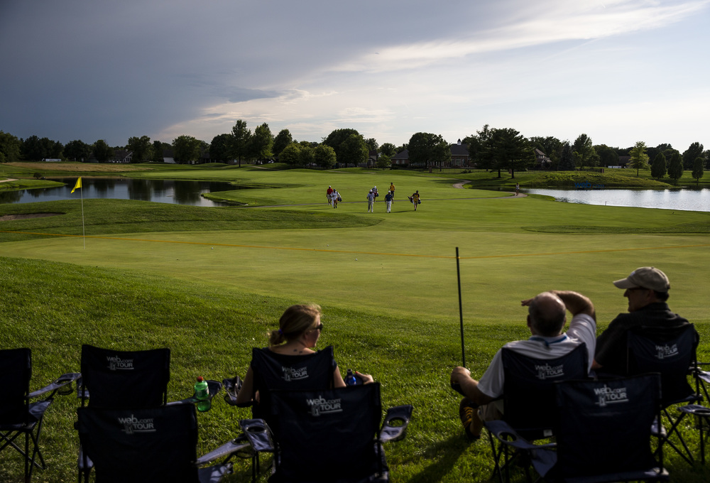 Fans take in the view of the 18th green as golfers approach the putting surface during the first day of the Web.com Tour's Lincoln Land Charity Championship at Panther Creek Country Club, Thursday, July 14, 2016, in Springfield, Ill. Justin L. Fowler/The State Journal-Register