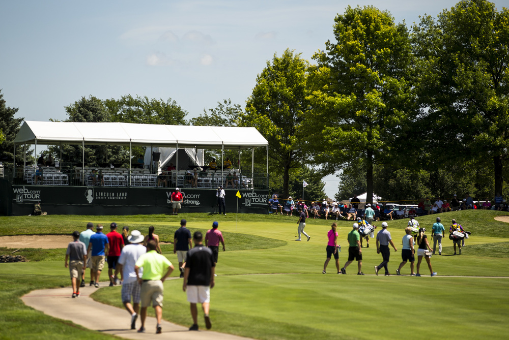 Fans make their way to the 18th green with Ollie Schniederjans's group during the second round of the Web.com Tour's Lincoln Land Charity Championship at Panther Creek Country Club, Friday, July 15, 2016, in Springfield, Ill. Justin L. Fowler/The State Journal-Register