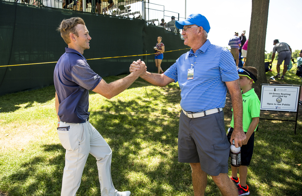 Jake Marriot, left, gets a handshake from Gil Bratten, after finishing his second round with a 3-under 68 during the second round of the Web.com Tour's Lincoln Land Charity Championship at Panther Creek Country Club, Friday, July 15, 2016, in Springfield, Ill. Justin L. Fowler/The State Journal-Register