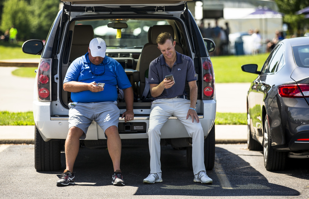 Jake Marriot, right, and his brother and caddie Bill Marriot Jr., left, check their phones after Marriot finished his round during the second round of the Web.com Tour's Lincoln Land Charity Championship at Panther Creek Country Club, Friday, July 15, 2016, in Springfield, Ill. Justin L. Fowler/The State Journal-Register