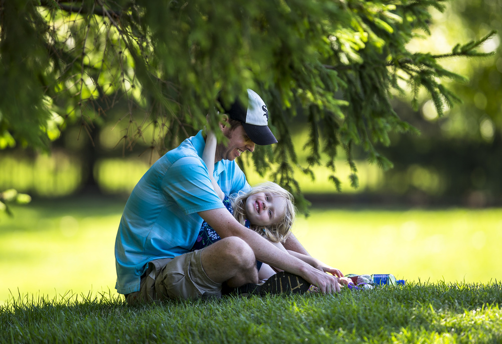 Brett Hage and his daughter, Madi, 4, enjoy the view from the shade on the No. 12 green while watching the action during the second round of the Web.com Tour's Lincoln Land Charity Championship at Panther Creek Country Club, Friday, July 15, 2016, in Springfield, Ill. Justin L. Fowler/The State Journal-Register