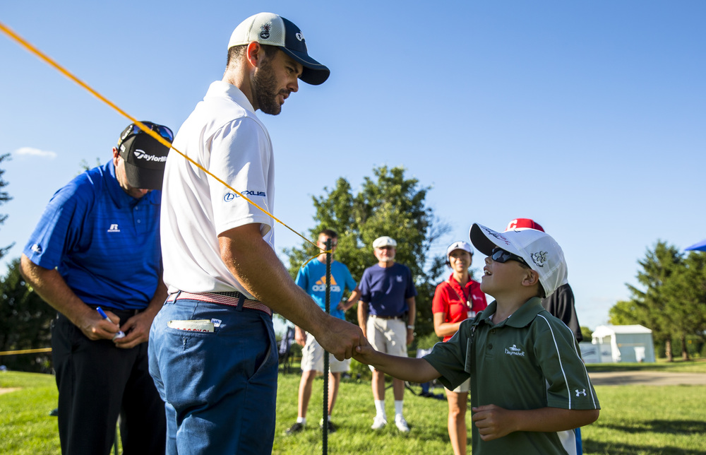 Ford Fontaine, 9, gets a handshake from Wesley Bryan after getting his hat signed as Bryan came off the No. 9 green after finishing his round during the second round of the Web.com Tour's Lincoln Land Charity Championship at Panther Creek Country Club, Friday, July 15, 2016, in Springfield, Ill. Fontaine is the nephew of Augusta University golfer and former SHG golfer Jake Marriot. Justin L. Fowler/The State Journal-Register