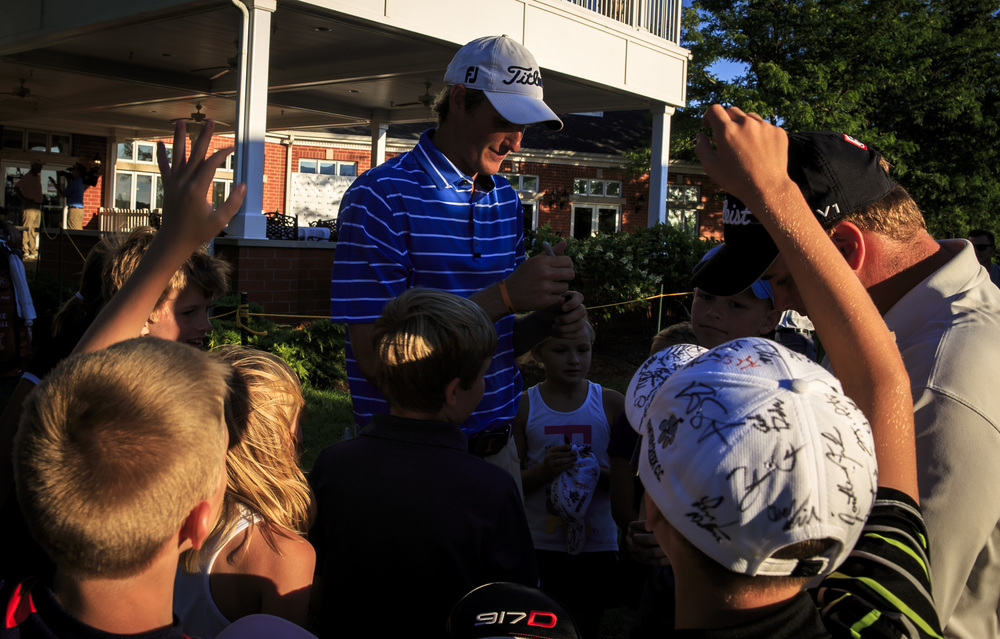 Charlie Danielson is swarmed by kids as he signs autographs after finishing with an even par 71 during the second round of the Web.com Tour's Lincoln Land Charity Championship at Panther Creek Country Club, Friday, July 15, 2016, in Springfield, Ill. Justin L. Fowler/The State Journal-Register