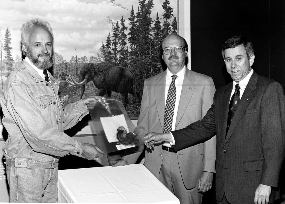 Gennady Baryshnikov presents gift of mammoth hair to ENR Director John Moore and Illinois State Museum Director, R. Bruce McMillan. Photo courtesy Illinois State Museum